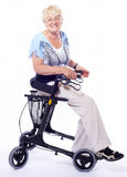 Senior woman sitting on walker Stock Photography