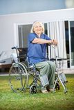 Senior Woman Sitting On Wheelchair At Nursing Home Stock Photography