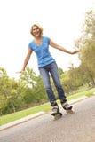 Senior Woman Skating In Park Stock Images