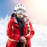 Senior woman in ski jacket and goggles outdoors Royalty Free Stock Photos
