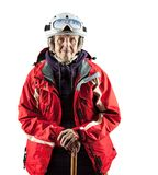 Senior woman in ski jacket and helmet over white Stock Photos
