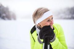 Senior woman skiing. Active senior woman skiing, having a break. Winter time royalty free stock image