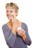 Senior woman with skin care Stock Images