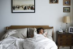 Senior woman sleeping alone on the bed Stock Images