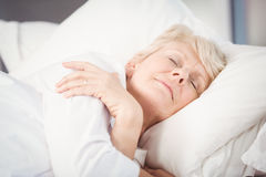 Senior woman sleeping on bed Stock Images