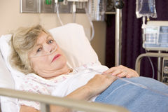 Senior Woman Sleeping In Hospital Bed Royalty Free Stock Photo