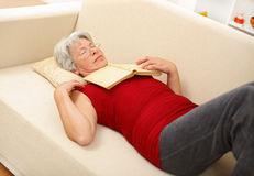 Senior woman sleeping on sofa Royalty Free Stock Photos