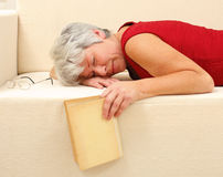 Senior woman sleeping on sofa Stock Images