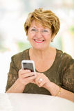 Senior woman smart phone Royalty Free Stock Photo