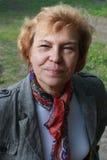 Senior woman smiles. Senoir woman looks at camera and smiles Stock Images