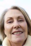 Senior Woman Smiling At The Camera Royalty Free Stock Photos