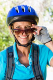 Senior woman is smiling with her bike Stock Photos