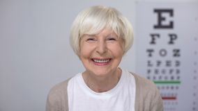Senior woman smiling after successful cataract removal surgery, focused vision. Stock footage stock video footage