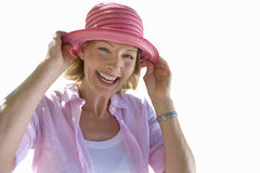 senior woman smiling, wearing sun hat, cut out royalty free stock photos