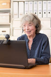 Senior woman smiling at webcam Royalty Free Stock Photos