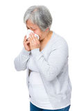 Senior woman sneeze Royalty Free Stock Photos