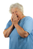 A senior woman sneezes Royalty Free Stock Images