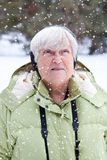 Senior Woman in Snowfall Stock Photography