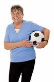Senior woman with soccer ball Royalty Free Stock Photos
