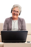 Senior woman on social network Royalty Free Stock Photography