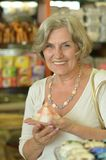 Senior woman at souvenir store Stock Images