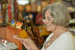 Senior woman at souvenir store Royalty Free Stock Photography
