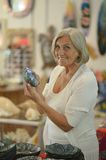 Senior woman at souvenir store Royalty Free Stock Image