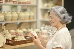 Senior woman at souvenir store Stock Images