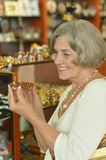 Senior woman at souvenir store Stock Image