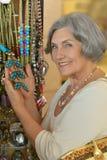 Senior woman at souvenir store Royalty Free Stock Image