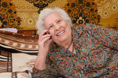 Senior woman speaks on the mobile phone Stock Photo