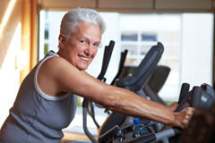 Senior woman on spinning bike Royalty Free Stock Photos