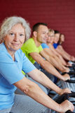 Senior woman in spinning class Royalty Free Stock Image