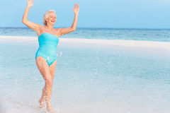 Senior Woman Splashing In Beautiful Tropical Sea Stock Photography