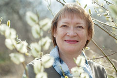 Senior woman  in spring willow Royalty Free Stock Photos