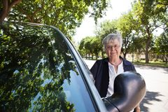 Senior woman Standing by Car Stock Photos