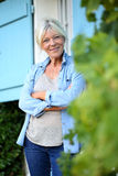 Senior woman standing in front of home Stock Photography