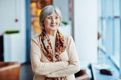 Senior woman standing indoors Royalty Free Stock Photos