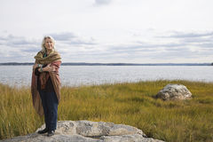 Senior woman standing near a lake Stock Photography