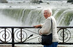 Senior woman standing at niagara falls Stock Image