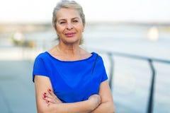 Senior woman standing outdoors Royalty Free Stock Photos