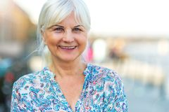 Senior woman standing outdoors Stock Photography
