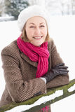 Senior Woman Standing Outside In Snowy Landscape. Smiling Senior Woman Standing Outside In Snowy Landscape Stock Images