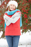 Senior Woman Standing Outside In Snowy Landscape. Smiling Royalty Free Stock Photos
