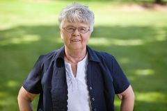 Senior woman standing in park Royalty Free Stock Images