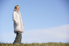 Senior Woman Standing In Park Stock Photos
