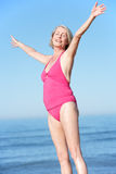Senior Woman Standing On Summer Beach Royalty Free Stock Photos