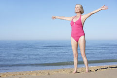 Senior Woman Standing On Summer Beach Stock Photos