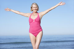 Senior Woman Standing On Summer Beach Royalty Free Stock Image