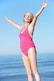 Senior Woman Standing On Summer Beach Royalty Free Stock Image